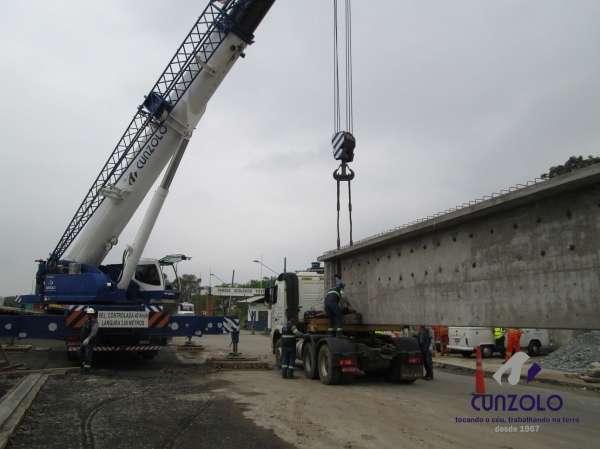 A Cunzolo realizou o içamento de 02 vigas de 30 metros de comprimento, 1,20 metros de largura e peso de 30 toneladas cada. Para essa operação foram utilizados 01 Guindaste Rodoviário Tadano ATF 220 (cap. 220 t.), 01 Guindaste Rodoviário Liebherr 220 (cap. 220 t.) e 02 carretas Dolly.
